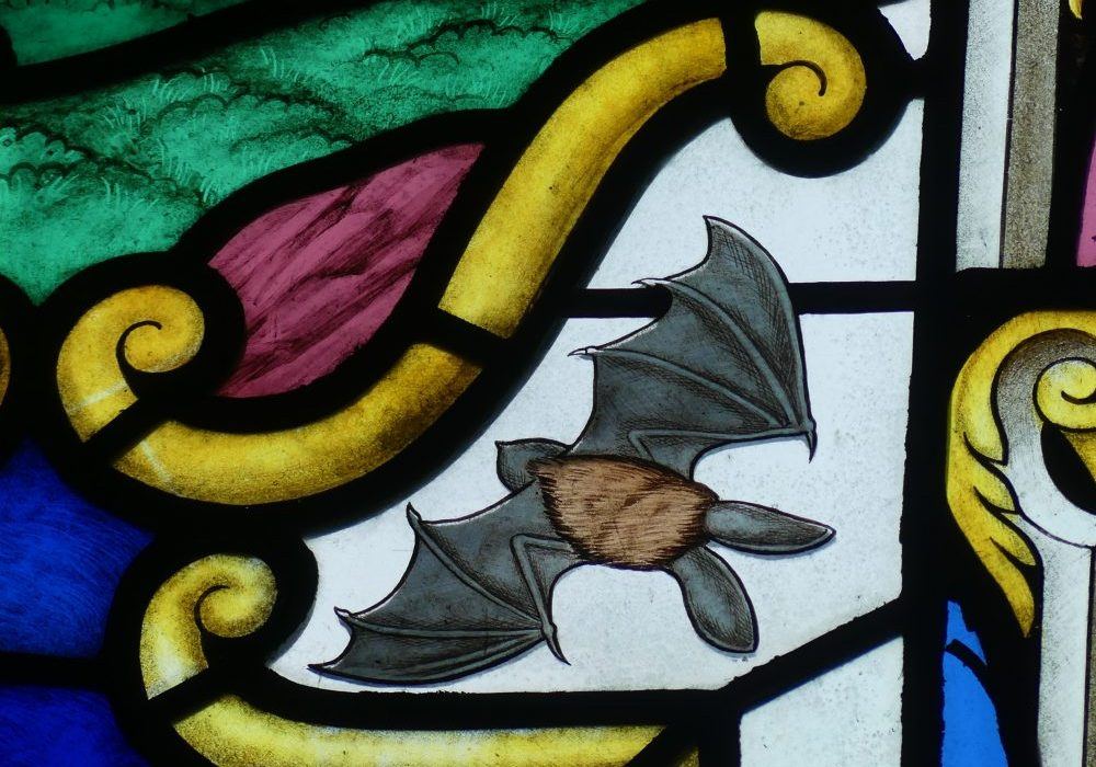 Stained glass bat at Netherseal church